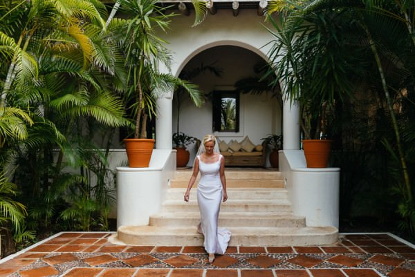 Bride Alison is a vision in her couture gown amidst a tropical setting.