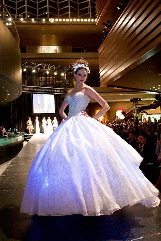 From runway to real life, this couture ball gown features custom LED technology that illuminates the skirt of the gown.