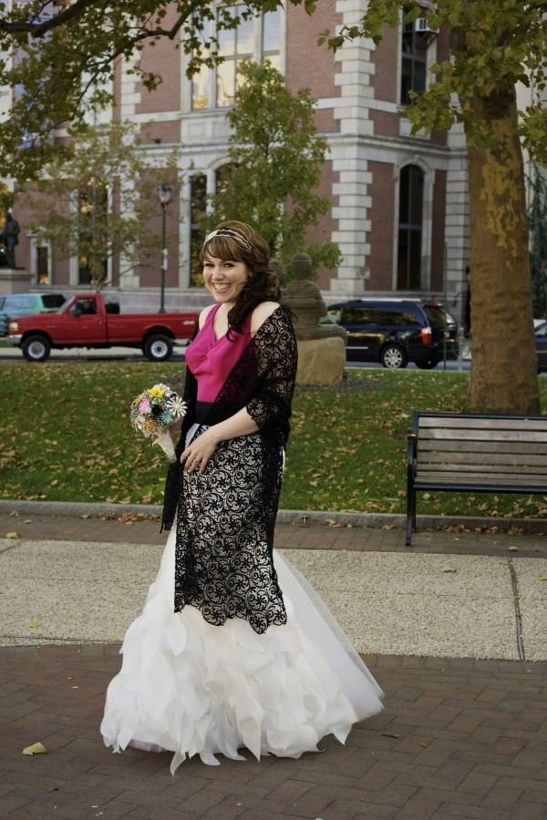 The bride completed her look with a vintage headpiece, hand-made brooch bouquet and a black lace shawl.