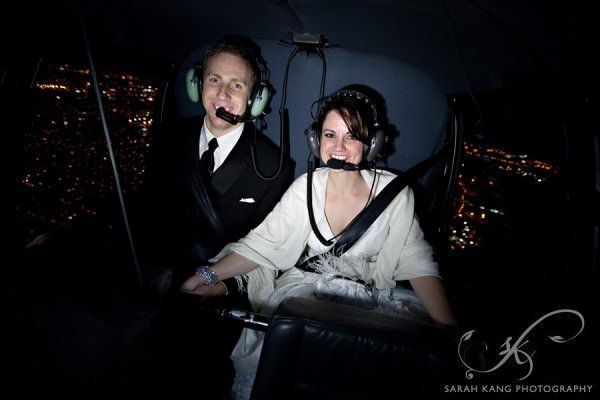 After their reception, the bride surprised her new groom with a nighttime helicopter tour over the city of Philadelphia.