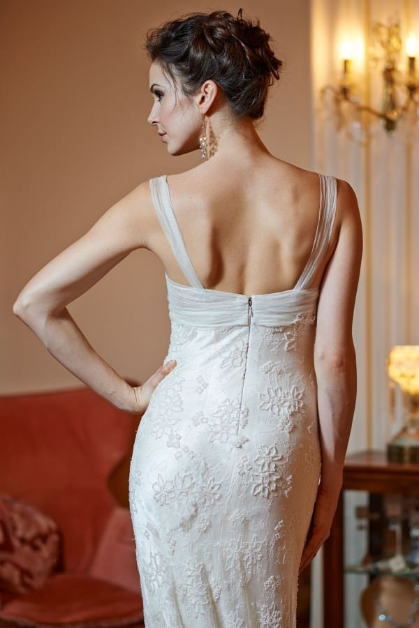 The wedding gown features a silk satin bustier and soft, flowing skirt.