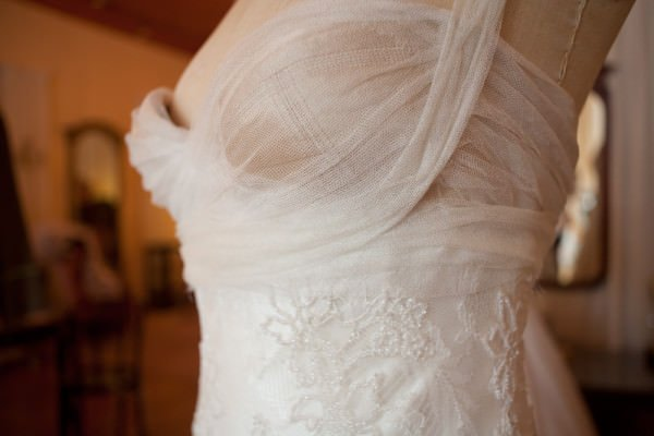 This detail shows the lace on the gown which was hand-beaded in France in a light floral design.