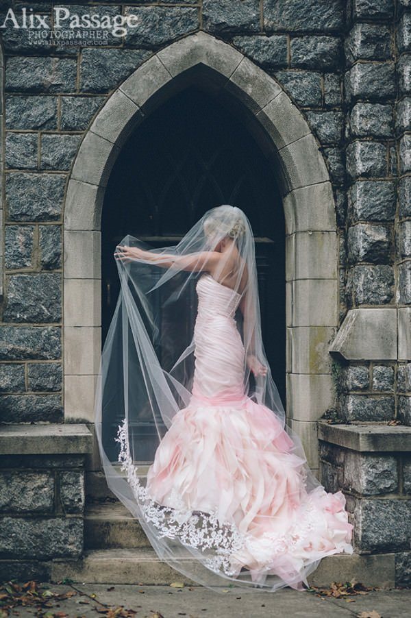 The bride is model-read for her big day, striking a pose in her dramatic gown.