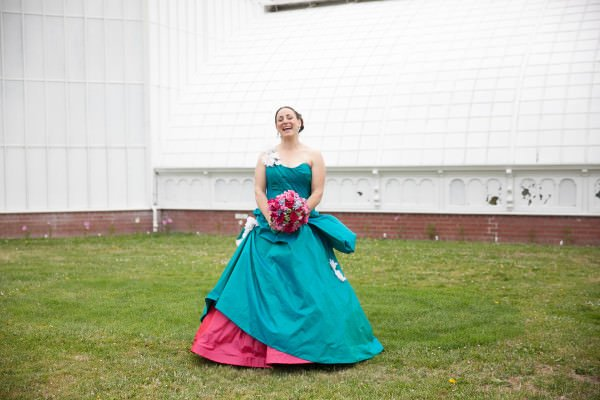 Lavinia and her husband were married at the Conservatory of Flowers in San Francisco, creating a minimal backdrop for her colorful gown.