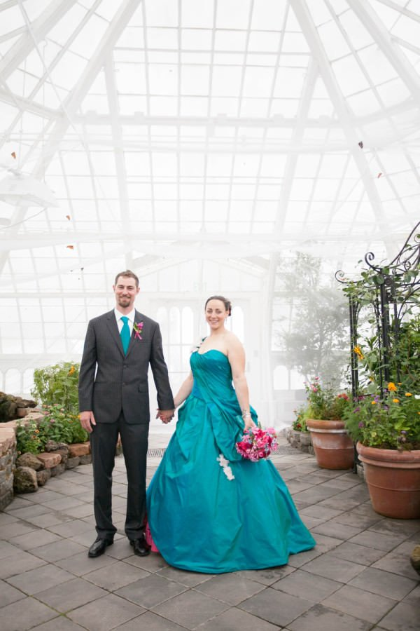 The bright white background of the conservatory and the West Coast fog allow the bride and groom to brighten the space.