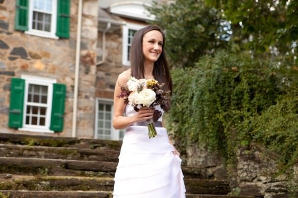 The strapless, tiered wedding gown is perfect for Nicola's outdoor, garden wedding.