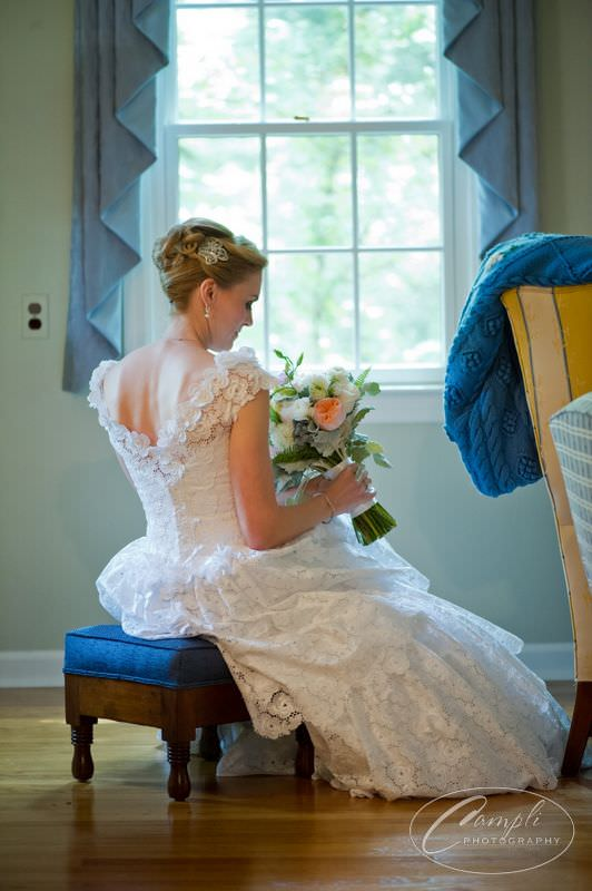Megan's couture wedding gown was designed in a gorgeous cotton eyelet fabric from the 1970s.