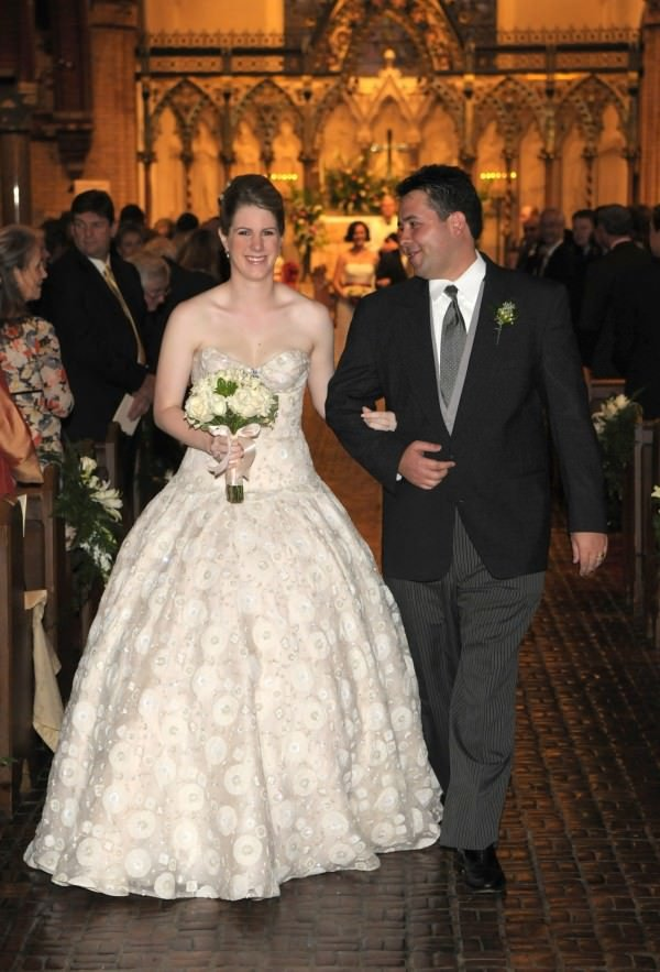 Bride Clare wears a full-skirted ball gown produced in a custom-made silk organza.