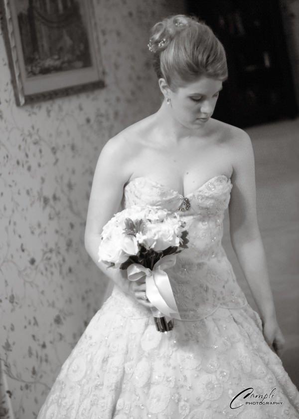 The custom silk organza fabric adds an extravagant, luxurious look to this traditional wedding gown shape.