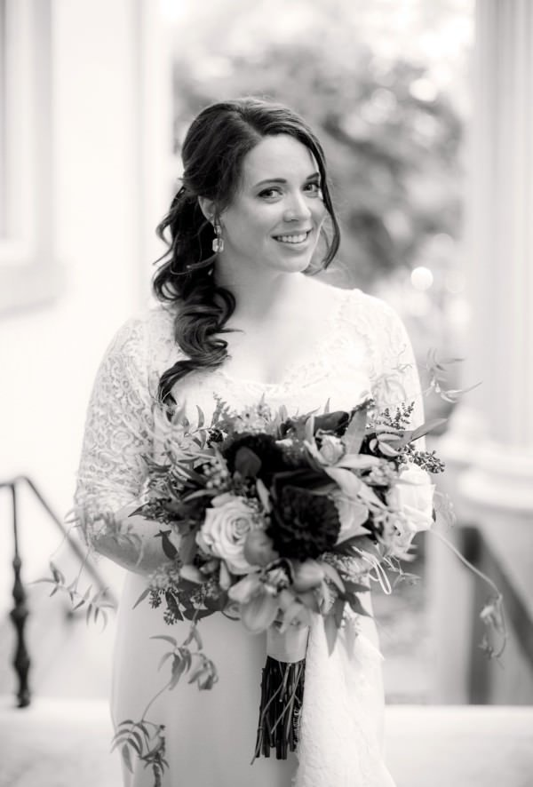 The bride wears a custom, one-of-a-kind wedding gown by Janice Martin Couture.
