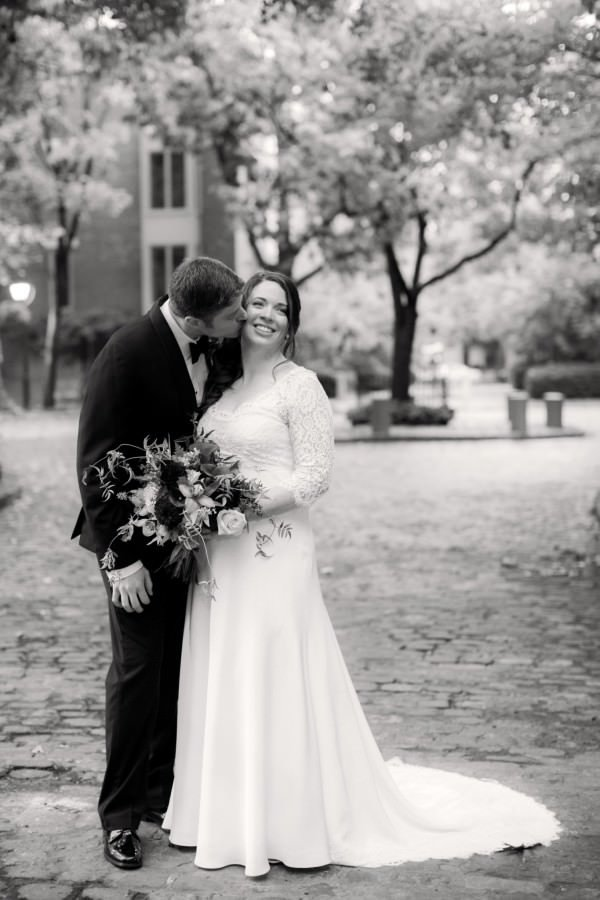 Bride Erin opted for traditional elegance with a lace bodice, lace sleeves and a-line skirt.