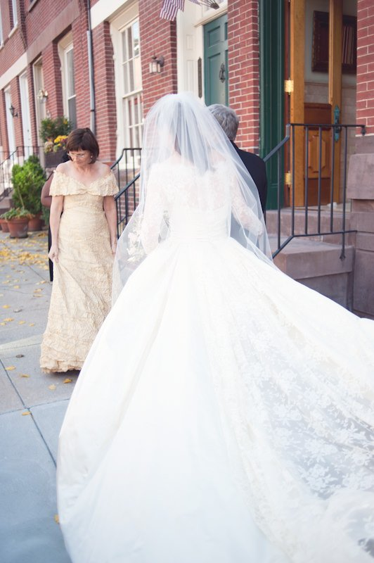 The extravagant gown features a long train with lace overlay.