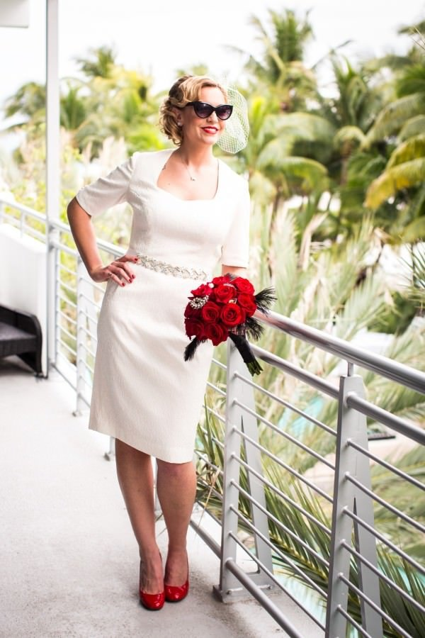 Megan's dress was inspired by Marilyn Monroe and features three-quarter length sleeves.