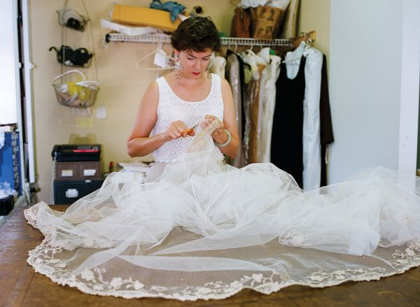 In her studio in 1997, Janice restores Princess Grace's veil.