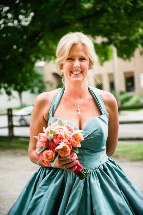 Bride Lynn makes a bold statement in her blue-green wedding gown.