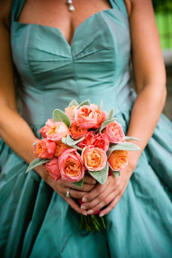 Lynn's coral bouquet and understated nude heels are the perfect compliment to her blue dress.
