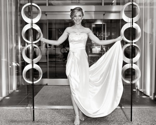 Jennifer wears her grandmother's restored and redesigned wedding dress in an updated, modern silhouette.