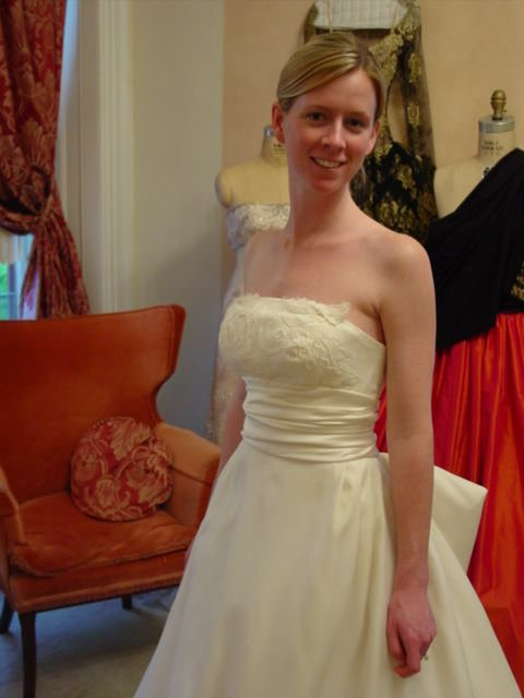 A full skirted wedding gown is restored for a modern bride.