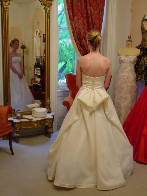 The sleeves of the original gown were removed to create a strapless silhouette.