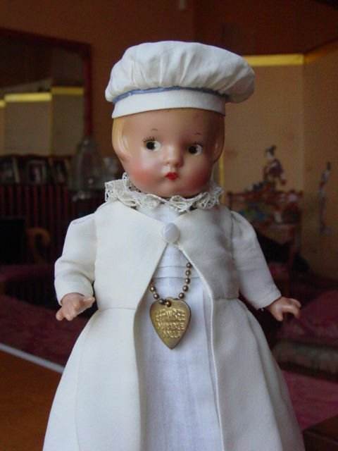 The client requested a replica of the Christening gown in miniature version for a doll.