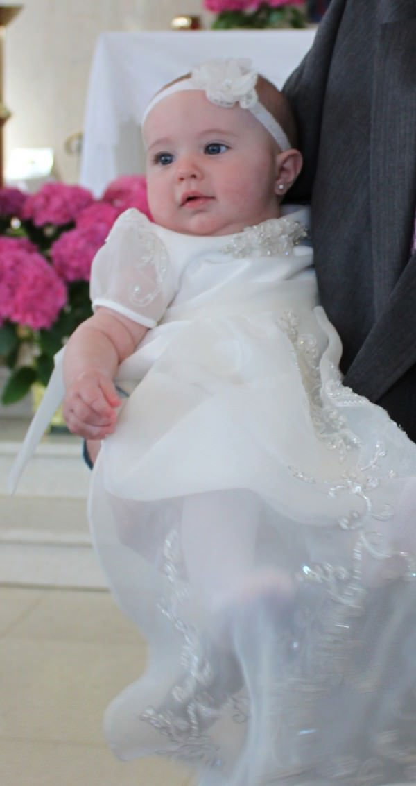 Many families are starting new traditions of transforming family wedding gowns into Christening gowns and suits.