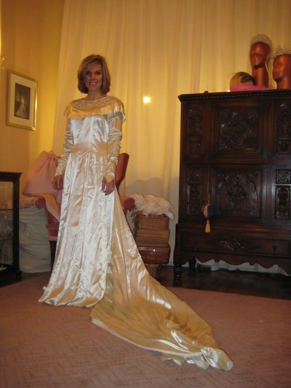 Jennifer wears her grandmother's vintage wedding gown before it was redesigned by Janice Martin Couture.