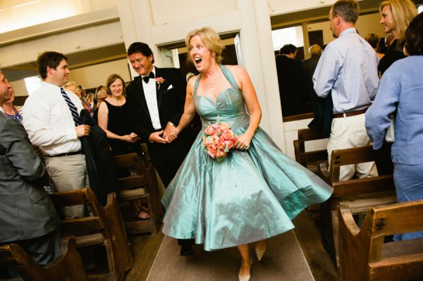 Bride Lynn is full of personality in her couture wedding dress as she walks down the aisle.