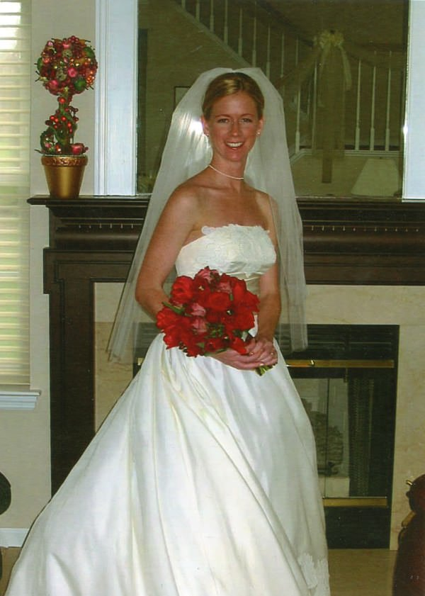 The bride on her wedding day in the redesigned ball gown.