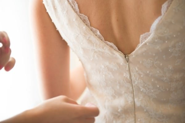 A detail view of the back of Allison's wedding dress.