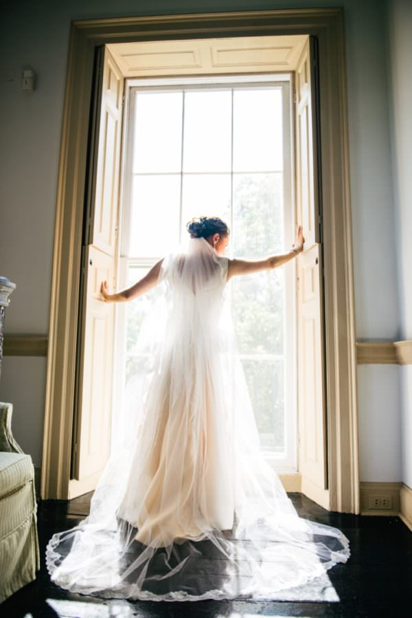 The bride is a vision in a heirloom wedding gown that represents over 93 years of marriage.