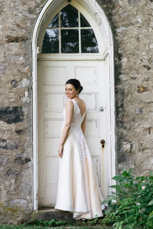 The skirt is designed in layers of new peach and white silk organza with lace from the original gown in the back.