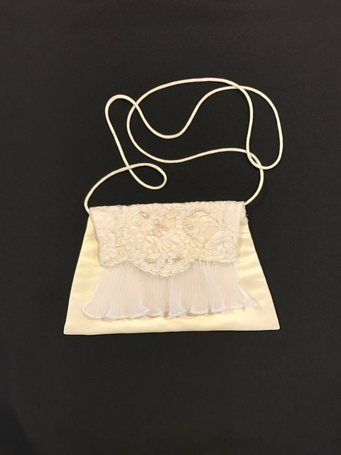 Heirloom wedding dress accent made into clutch purse