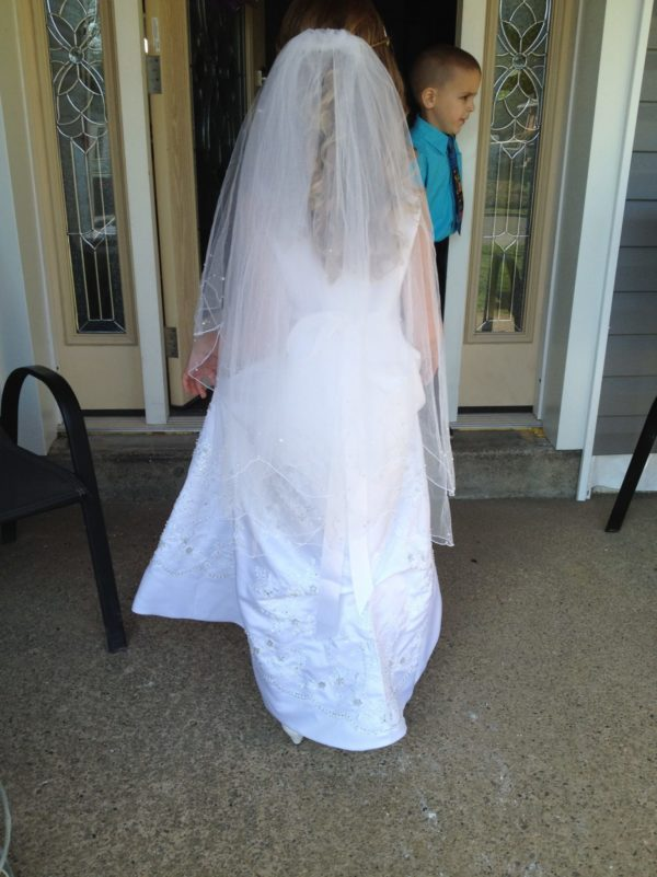 A Communion Gown created from the mother's wedding gown.